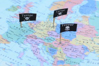 "skull and crossbones flag pins, marked ""TERROR,&quote stuck in map of Europe"